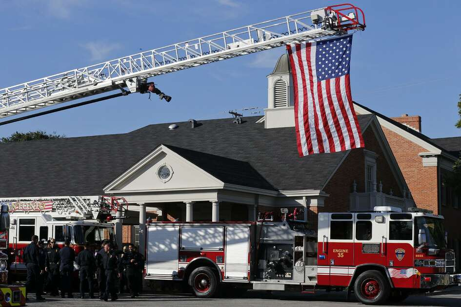 First responders stand outside Porter Loring Mortuary on Thursday.