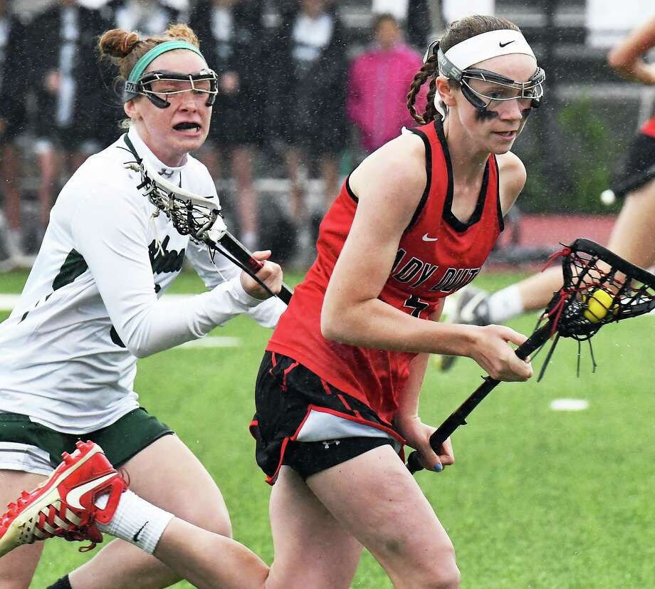 Shen's #8 Carli Pelletier, left, and Guilderland's #5 Kerry Gerety race downfield during their Class A final Thursday May 25, 2017 in Rotterdam, NY.  (John Carl D'Annibale / Times Union) Photo: John Carl D'Annibale / 20040596A