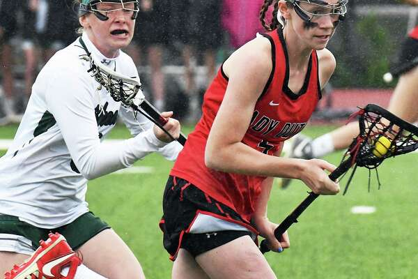 Shen's #8 Carli Pelletier, left, and Guilderland's #5 Kerry Gerety race downfield during their Class A final Thursday May 25, 2017 in Rotterdam, NY.  (John Carl D'Annibale / Times Union)