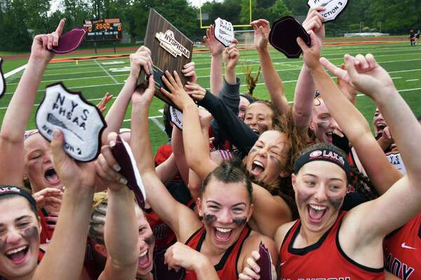 Guilderland' players celebrate their overtime win against Shenendehowa in the Class A final Thursday May 25, 2017 in Rotterdam, NY.  (John Carl D'Annibale / Times Union)