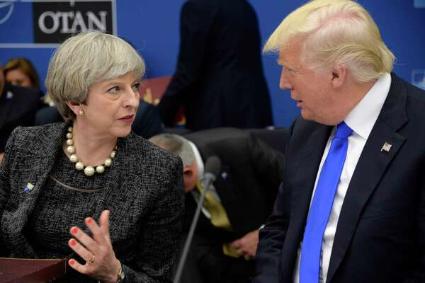 US President Donald Trump, right, speaks with British Prime Minister Theresa May as they participate in a working dinner meeting, during the NATO summit of heads of state and government, at the NATO headquarters, in Brussels on Thursday, May 25, 2017. US President Donald Trump inaugurated the new headquarters during a ceremony on Thursday with other heads of state and government. (Thierry Charlier/Pool Photo via AP) ORG XMIT: LON81