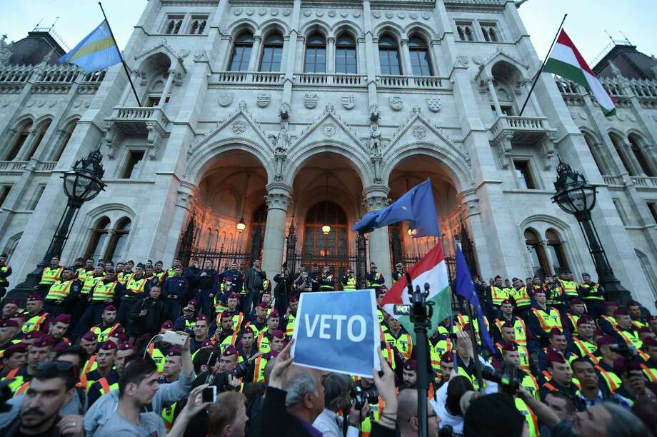 FILE - In this April 4, 2017 file photo demonstrators face policemen as they protest against the amendment of the higher education law seen by many as an action aiming at the closure of the Central European University, founded by Hungarian born American billionaire businessman George Soros, in front of the Parliament building in Budapest, Hungary's government says Thursday, May 25, 2017  it sees no reason to alter its recently amended education law which could force a university founded by billionaire George Soros to leave the country.  (Zoltan Balogh/MTI via AP, file) ORG XMIT: XBUD101 Photo: Zoltan Balogh / MTVA - Media Service Support and Asset Management Fund