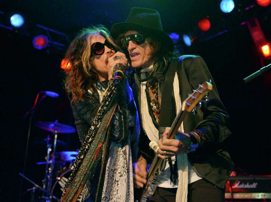 "FILE - In this April 8, 2014 file photo, Steven Tyler, left, and Joe Perry of Aerosmith perform at the Whisky A Go Go in Los Angeles.  Though others are canceling events and concerts after the terror attacks at an Ariana Grande concert in England, Aerosmith have decided to still perform. Perry said in an interview Thursday, May 25, 2017, in Munich that the band ""doesn't want to live like that"" and ""the fans don't want to live like that."" Aerosmith will play Munich on Friday on its Aero-Vederci Baby! Tour. (Photo by John Shearer/Invision/AP, File) ORG XMIT: NYET409 Photo: John Shearer / Invision"