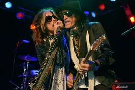 """FILE - In this April 8, 2014 file photo, Steven Tyler, left, and Joe Perry of Aerosmith perform at the Whisky A Go Go in Los Angeles.  Though others are canceling events and concerts after the terror attacks at an Ariana Grande concert in England, Aerosmith have decided to still perform. Perry said in an interview Thursday, May 25, 2017, in Munich that the band """"doesn't want to live like that"""" and """"the fans don't want to live like that."""" Aerosmith will play Munich on Friday on its Aero-Vederci Baby! Tour. (Photo by John Shearer/Invision/AP, File) ORG XMIT: NYET409"""