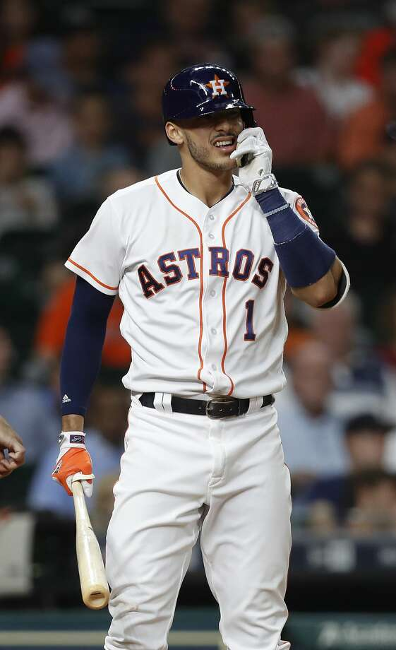Houston Astros shortstop Carlos Correa (1) tugs at the face protector on his batting helmet during the seventh inning of an MLB baseball game at Minute Maid Park, Thursday, May 25, 2017.   ( Karen Warren / Houston Chronicle ) Photo: Karen Warren/Houston Chronicle