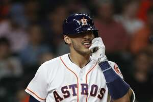 Houston Astros shortstop Carlos Correa (1) tugs at the face protector on his batting helmet during the seventh inning of an MLB baseball game at Minute Maid Park, Thursday, May 25, 2017.   ( Karen Warren / Houston Chronicle )