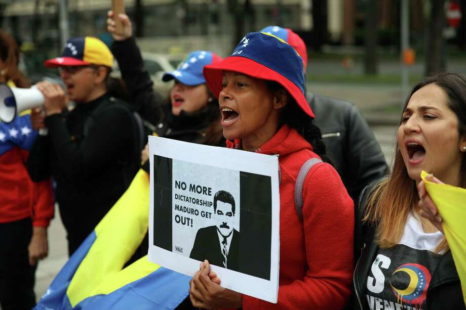 A demonstrator makes her feelings known about Venezuelan President Nicolas Maduro on Thursday outside the 172nd Organization of the Petroleum Exporting Countries meeting in Vienna, Austria. According to emails and documents, Syria and Venezuela sought to evade international sanctions via a Russian company. Photo: Akos Stiller / © 2017 Bloomberg Finance LP