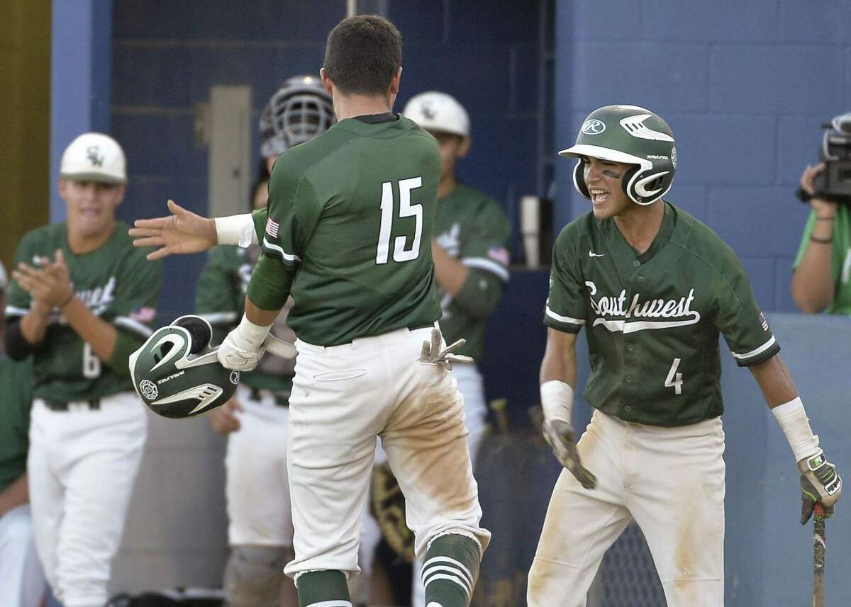 Southwest's Gabe Rivera (4) celebrates a run by teammate Isaiah Zavala (15) against Reagan during game one of their Region IV-6A semi-final playoff baseball series, Thursday, May 25, 2017, at SAISD Sports Complex in San Antonio. Reagan won 9-1. (Darren Abate/For the Express-News)