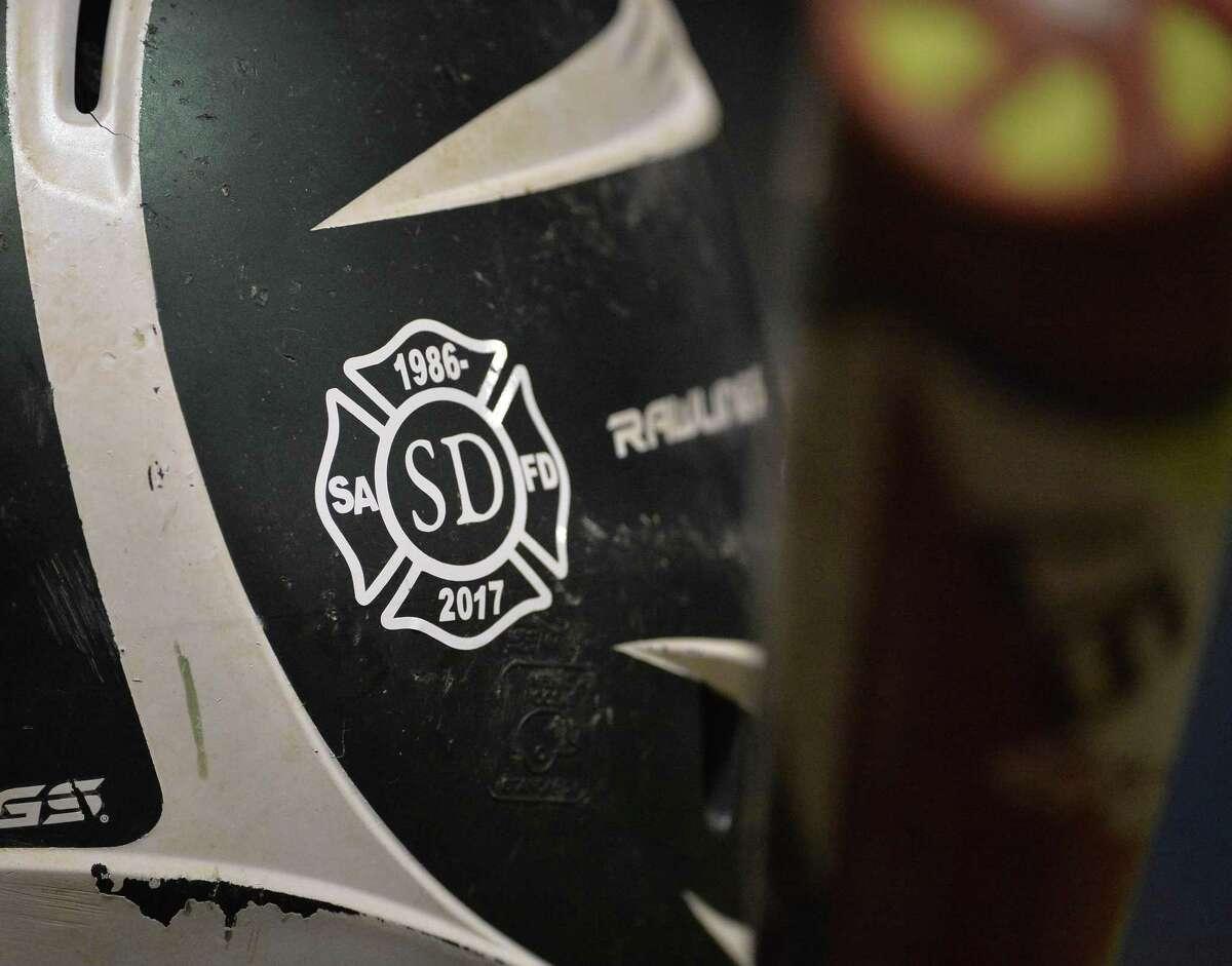Southwest players wore a tribute to fallen San Antonio firefighter Scott Deem, a Southwest alum, on their batting helmets.