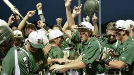 Reagan players celebrate a run during Game 1 of their Region IV-6A semifinal playoff baseball series against Southwest on May 25, 2017, at SAISD Sports Complex in San Antonio.