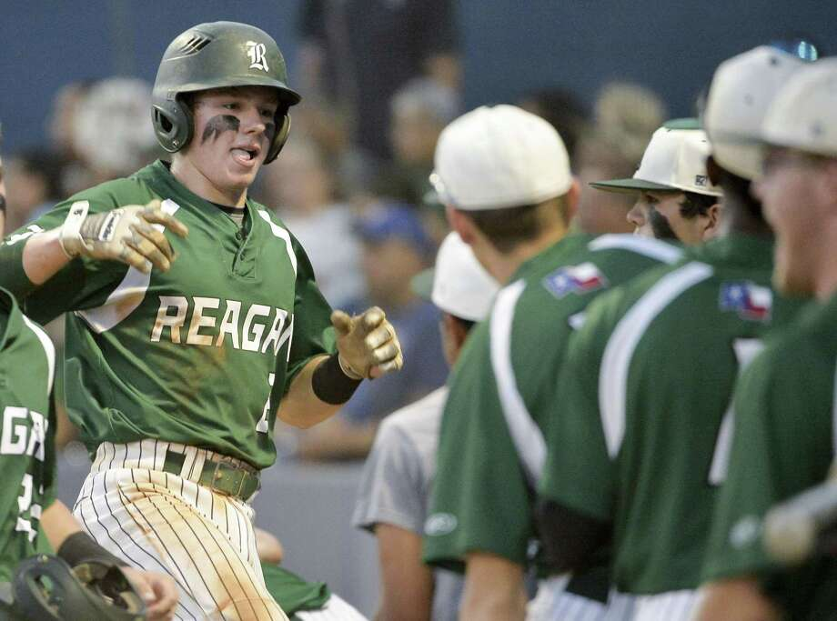 Reagan's Josh Killeen (left) celebrates a run with teammates this season. The Rattlers' clean-up hitter is batting .376 with 32 RBIs. Photo: Darren Abate / Darren Abate / San Antonio Express-News