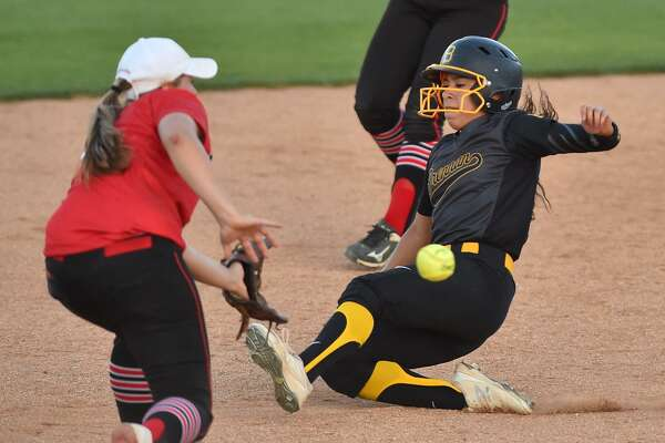 Brennan's Alexandria Torres slides into second base ahead of the throw to New Braunfel's Canyon's Sydney Owens during the Region IV-6A regional final series at St. Mary's University Thursday evening.