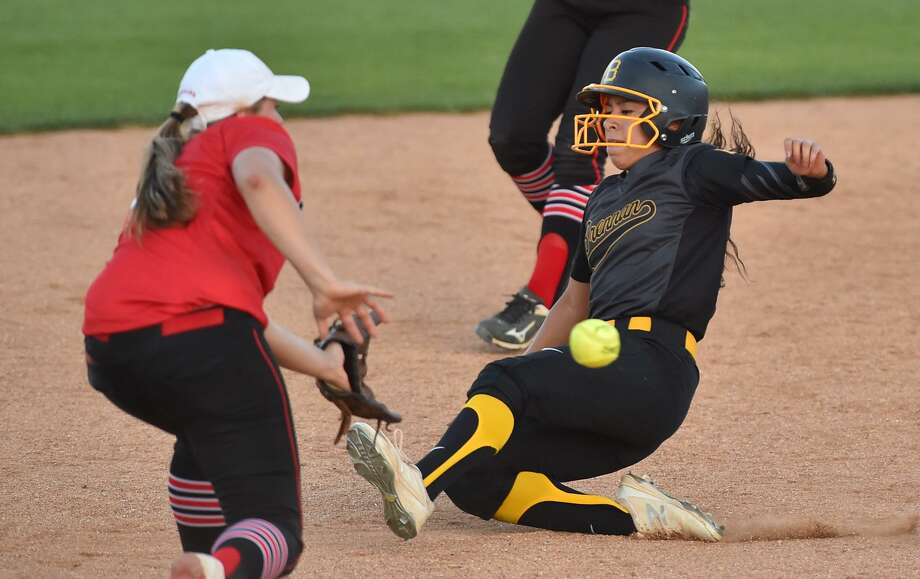 Brennan's Alex Torres slides into second base ahead of the throw to New Braunfel's Canyon's Sydney Owens during the Region IV-6A regional final series at St. Mary's University on May 25, 2017. Photo: Robin Jerstad /For The Express-News / ROBERT JERSTAD