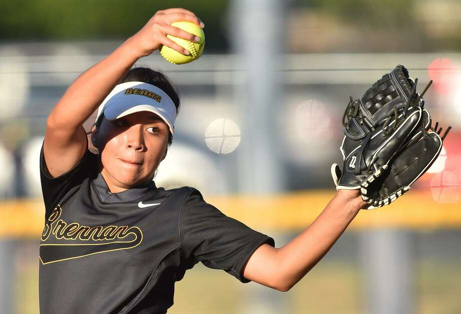 Brennan pitcher Clarissa Hernandez winds up to throw to the plate during the Region IV-6A regional final series againstNew Braunfels Canyon at St. Mary's University on May 25, 2017. Photo: Robin Jerstad /San Antonio Express-News / ROBERT JERSTAD