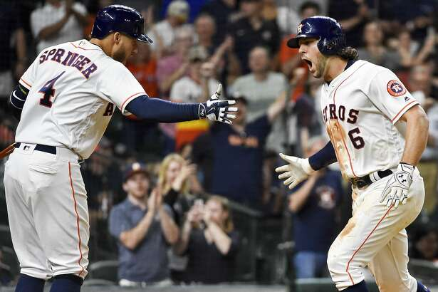 Houston Astros' Jake Marisnick (6) celebrates his go-ahead solo home run off relief pitcher Alex Wilson (30) with George Springer during the eighth inning of a baseball game, Thursday, May 25, 2017, in Houston. (AP Photo/Eric Christian Smith)