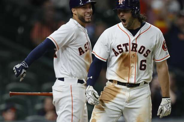 Houston Astros Jake Marisnick (6) celebrates his game winning home run with George Springer during the eighth inning of an MLB baseball game at Minute Maid Park, Thursday, May 25, 2017.   ( Karen Warren / Houston Chronicle )