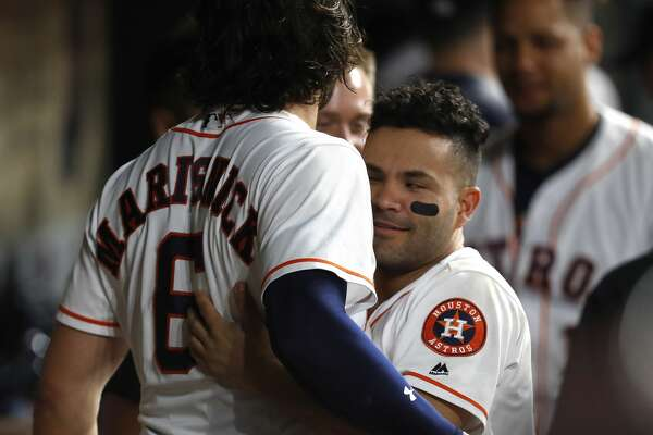 Houston Astros Jake Marisnick (6) celebrates his game winning home run with Jose Altuve during the eighth inning of an MLB baseball game at Minute Maid Park, Thursday, May 25, 2017.   ( Karen Warren / Houston Chronicle )