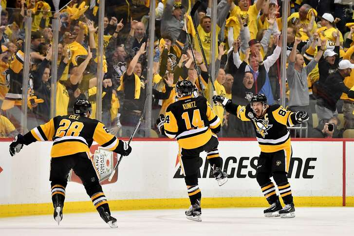PITTSBURGH, PA - MAY 25:  Chris Kunitz #14 of the Pittsburgh Penguins celebrates with Sidney Crosby #87 and Ian Cole #28 after scoring a goal agianst Craig Anderson #41 of the Ottawa Senators in the second overtime with a score of 3 to 2 in Game Seven of the Eastern Conference Final during the 2017 NHL Stanley Cup Playoffs at PPG PAINTS Arena on May 25, 2017 in Pittsburgh, Pennsylvania.  (Photo by Jamie Sabau/Getty Images)