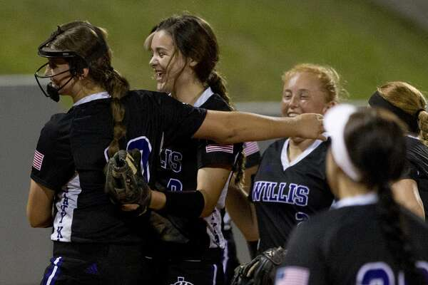 Willis shortstop McKenzie Parker (9) reacts with starting pitcher Casey Dixon (10) after making a diving play on a hit by Autumn Dawson #9 of Barbers Hill during the fifth inning in Game 1 of a Region III-5A final high school softball series at Cougar Softball Stadium, Thursday, May 25, 2017, in Houston.