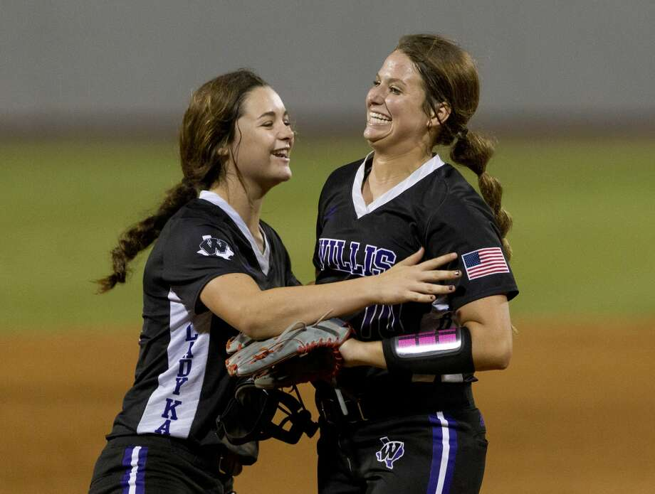 Willis starting pitcher Casey Dixon, right, get a hug from shortstop McKenzie Parker after getting Matee Simon #1 of Barbers Hill to ground out to compete Dixon's one-hitter in Game 1 of a Region III-5A final high school softball series at Cougar Softball Stadium, Thursday, May 25, 2017, in Houston. Willis defeated Barbers Hill 6-0. Photo: Jason Fochtman/Houston Chronicle