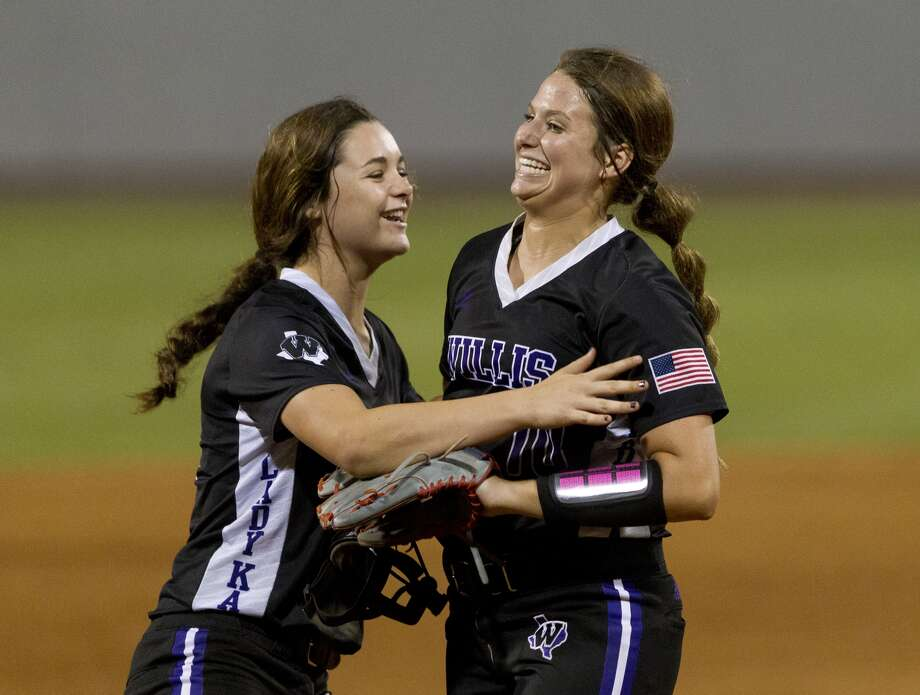 Willis starting pitcher Casey Dixon, right, get a hug from shortstop McKenzie Parker after getting Matee Simon #1 of Barbers Hill to ground out to compete Dixon's one-hitter in Game 1 of a Region III-5A final high school softball series at Cougar Softball Stadium, Thursday, May 25, 2017, in Houston. Willis defeated Barbers Hill 6-0.