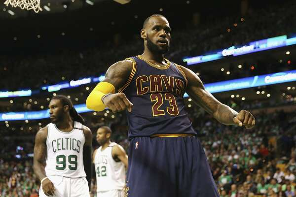 BOSTON, MA - MAY 25:  LeBron James #23 of the Cleveland Cavaliers celebrates his dunk in the third quarter as Jae Crowder #99 of the Boston Celtics looks on during Game Five of the 2017 NBA Eastern Conference Finals at TD Garden on May 25, 2017 in Boston, Massachusetts. NOTE TO USER: User expressly acknowledges and agrees that, by downloading and or using this photograph, User is consenting to the terms and conditions of the Getty Images License Agreement.  (Photo by Elsa/Getty Images)