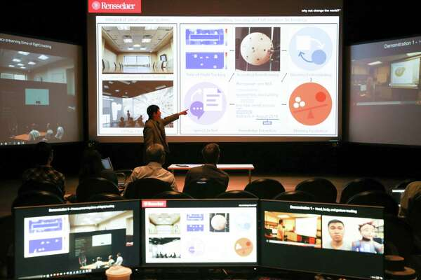 """Students at Rensselaer Polytechnic Institute demonstrate a new """"situations room"""" that is connected the the Watson supercomputer from IBM."""