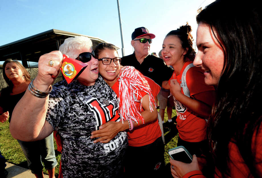 Lamar's softball team is welcomed by fans, including long-time fan Kay Ptacek, who hugged each player and offered them words of encouragement and congratulations after making their return to their home stadium complex Thursday night. The team had an upsetting loss in the NISC tournament championship, which many are contesting as unfair and due to poor planning and decisions over bad weather on behalf of officials. Photo taken Thursday, May 25, 2017 Kim Brent/The Enterprise Photo: Kim Brent / BEN