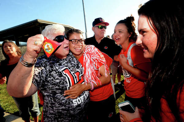 Lamar's softball team is welcomed by fans, including long-time fan Kay Ptacek, who hugged each player and offered them words of encouragement and congratulations after making their return to their home stadium complex Thursday night. The team had an upsetting loss in the NISC tournament championship, which many are contesting as unfair and due to poor planning and decisions over bad weather on behalf of officials. Photo taken Thursday, May 25, 2017 Kim Brent/The Enterprise
