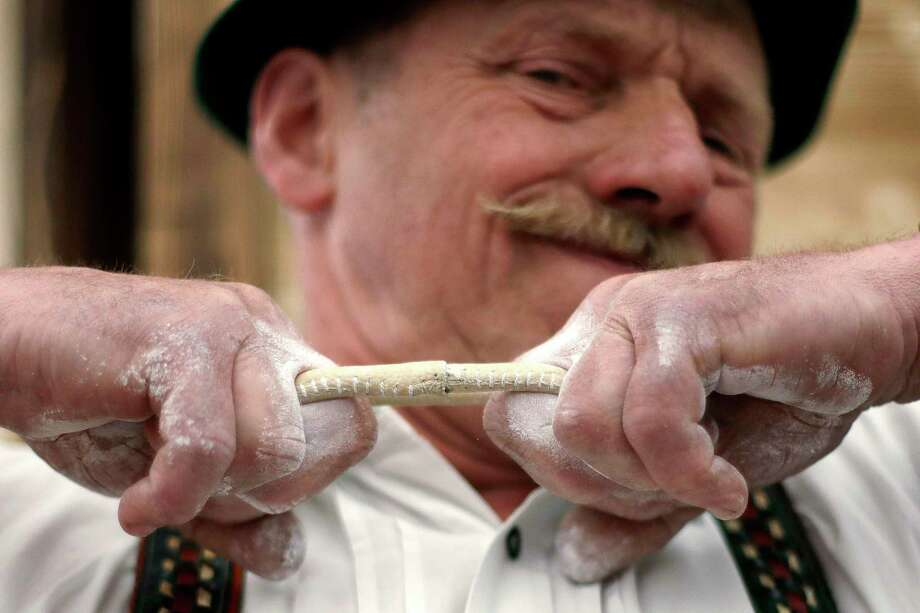 Georg Schoettl from Ohlstadt near Murnau warms up with a leather strap prior to his fight at the 40th Alpine Country Championships in Fingerhakeln_finger wrestling_ in Woernsmuehl, Germany, Thursday, May 25, 2017. Competitors battled for the title in this traditional rural sport where the winner has to pull his opponent over a marked line on the table. (AP Photo/Matthias Schrader) Photo: Matthias Schrader, STF / AP