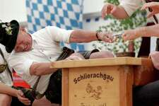 Georg Schoettl from Ohlstadt near Murnau tries to pull his opponent over the table at the 40th Alpine Country Championships in Fingerhakeln_finger wrestling_ in Woernsmuehl, Germany, Thursday, May 25, 2017. Competitors battled for the title in this traditional rural sport where the winner has to pull his opponent over a marked line on the table.(AP Photo/Matthias Schrader)