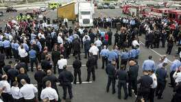 More than five hundred gathered for an apparatus procession led by the San Antonio Fire Department for fallen firefighter Scott Deem in San Antonio, Texas on May 26, 2017. Ray Whitehouse / for the San Antonio Express-News