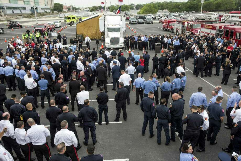 More than five hundred gathered for an apparatus procession led by the San Antonio Fire Department for fallen firefighter Scott Deem in San Antonio, Texas on May 26, 2017. Ray Whitehouse / for the San Antonio Express-News Photo: Ray Whitehouse, Photographer / For The San Antonio Express-News