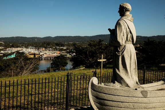 St. Junipero Serra statue in the Lower Presidio Historic Park overlooks the Fisherman's Wharf in Monterey, Calif. Thursday, May 18, 2017.