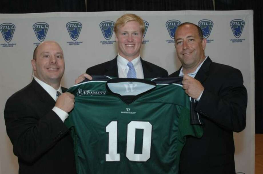 Old Greenwich's Parker McKee holds up a Lizards jersey afte rbeing chosen No. 4 overall by Long Island Lizards at Sunday night's Major League Lacrosse draft. Flanking McKee are MLL comissioner David Gross, left, and Lizards coach Jim Mule. Photo: Contributed Photo, Majore League Lacrosse/Contributed Photo / Greenwich Time Contributed
