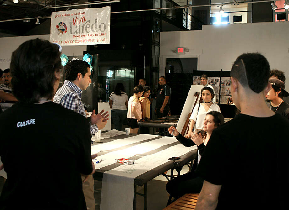 Members of the community of Laredo discussing the various propositions presented by the Viva Laredo Team to diversify the economy and improve quality of life at the Laredo Center for the Arts on Thursday evening. Photo: Francisco Vera/Laredo Morning Times