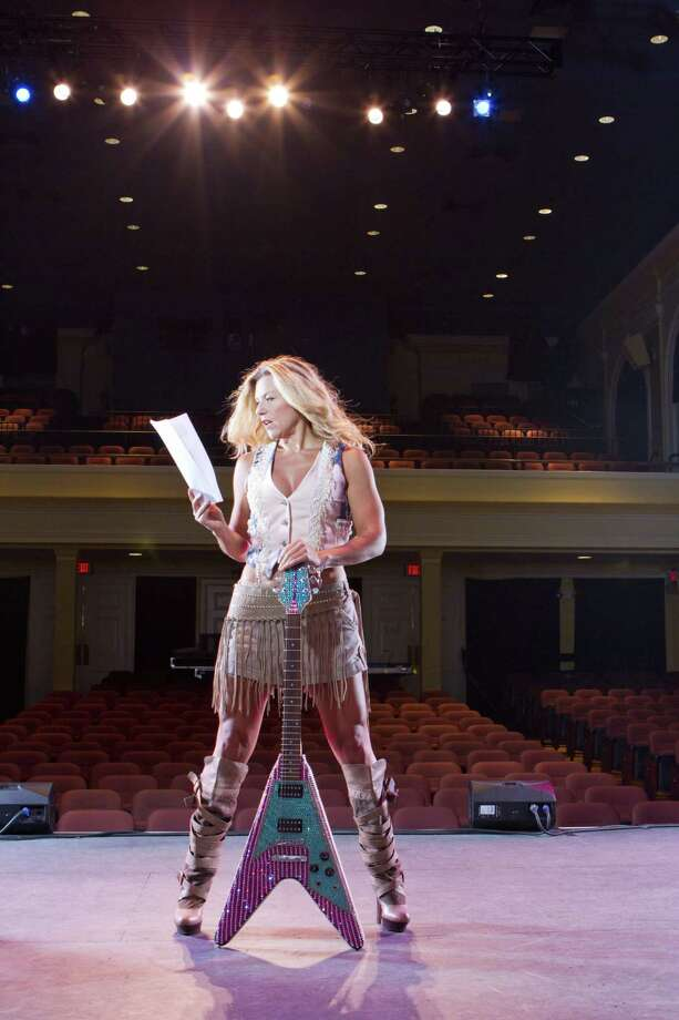 Allison Stockel, executive director of the Ridgefield Playhouse, looks over a script while standing on stage. Photo: Contributed Photo / / The News-Times Contributed