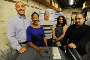 From left; Owners Herman and Carol Green, and employees Jose Orsini, Diane Melendez, and Lorenzo Machuca, in the warehouse at Benman Industries at 1870 East Main Street in Bridgeport, Conn. on Tuesday, May 23, 2017.