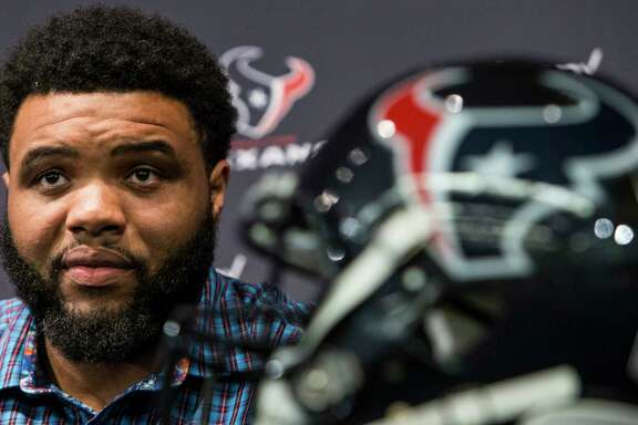 Houston Texans guard Jeff Allen holds up his jersey as he is introduced during a news conference announcing his signing at NRG Stadium on Thursday, March 10, 2016, in Houston. The Texans introduced four free agent signees Thursday, including quarterback Brock Osweiler, running back Lamar Miller, center, Tony Bergstrom and Allen. ( Brett Coomer / Houston Chronicle )