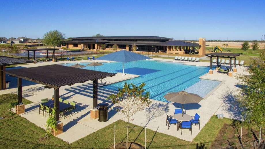 Elyson residents enjoy poolside service from the Rorick Kitchen cafe at this new community in the Katy ISD. Elyson offers new homes priced from the mid-$200,000s to $600,000s.