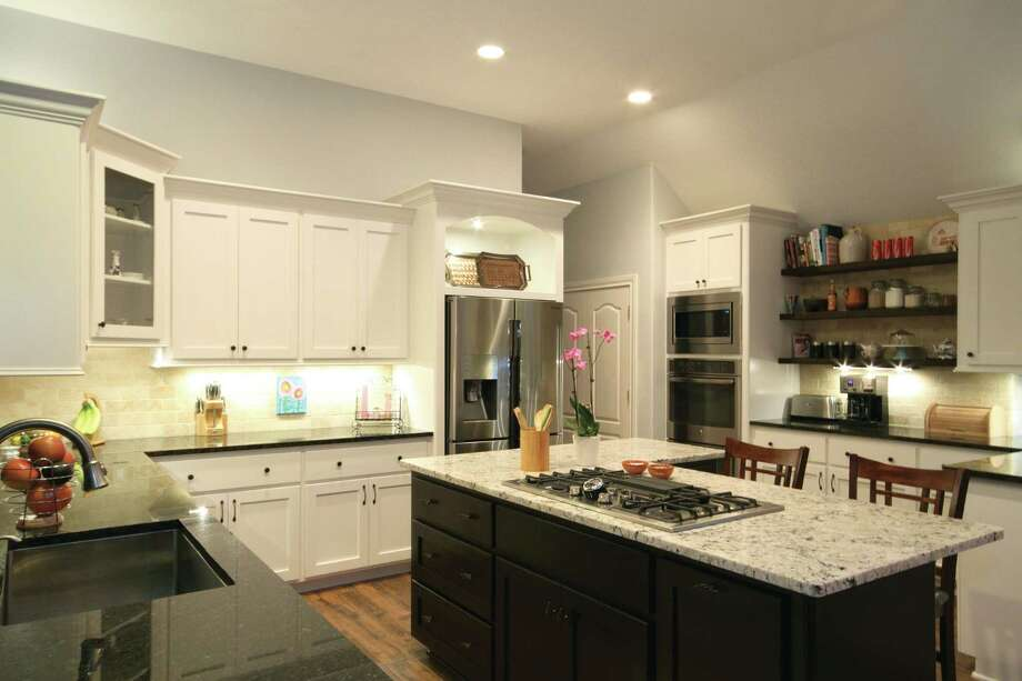 This kitchen was remodeled while the homeowner was away. Photo: Courtesy Of Vick Construction & Remodeling Inc.