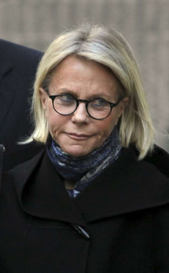 """In this April 6, 2009 file photo, Ruth Madoff is escorted by private security as she leaves the Metropolitan Correctional Center after visiting her husband, disgraced financier Bernard Madoff , in New York. Ruth Madoff and her son Andrew will speak publicly for the first time about Bernie Madoff on """"60 minutes"""" airing Sunday, Oct. 30 at 7pm. Photo: Mary Altaffer / Associated Press / AP2009"""