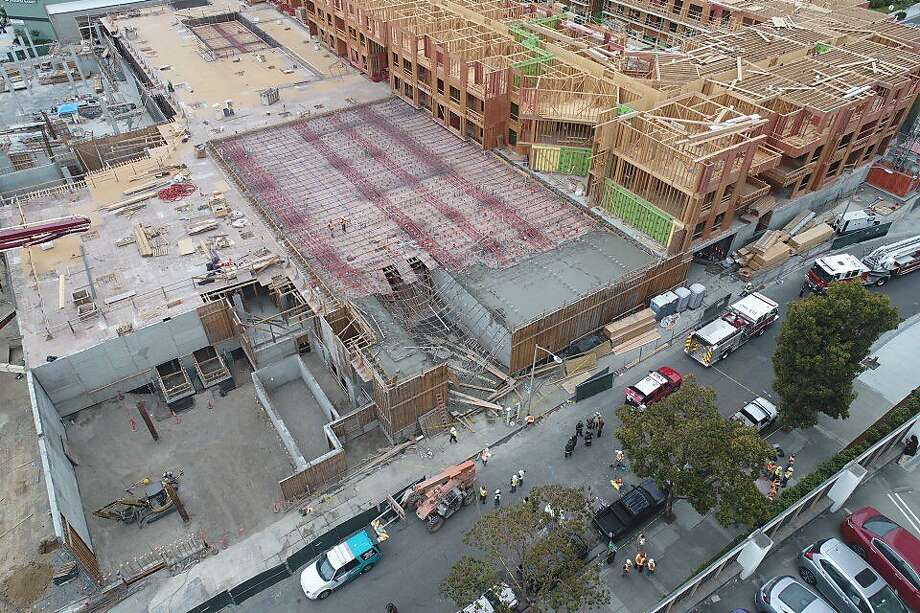 Thirteen workers were injured when a building collapsed at an Oakland construction site near downtown on May 26, 2017. Photo: Jim Stone, Special To The Chronicle
