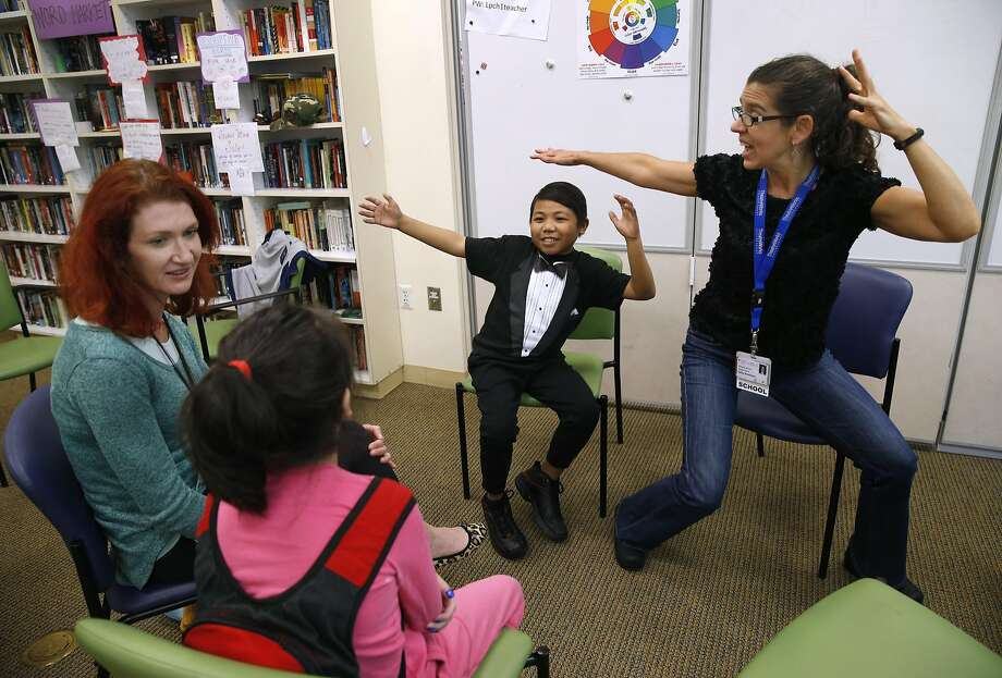 Jenny Debevec (left) and Kelly Rinehart (right) teach an improvisation class for Ziyan Liu, 10, and Keenan Espiritu, 15, at the Lucile Packard Children's Hospital school at Stanford. Photo: Paul Chinn, The Chronicle