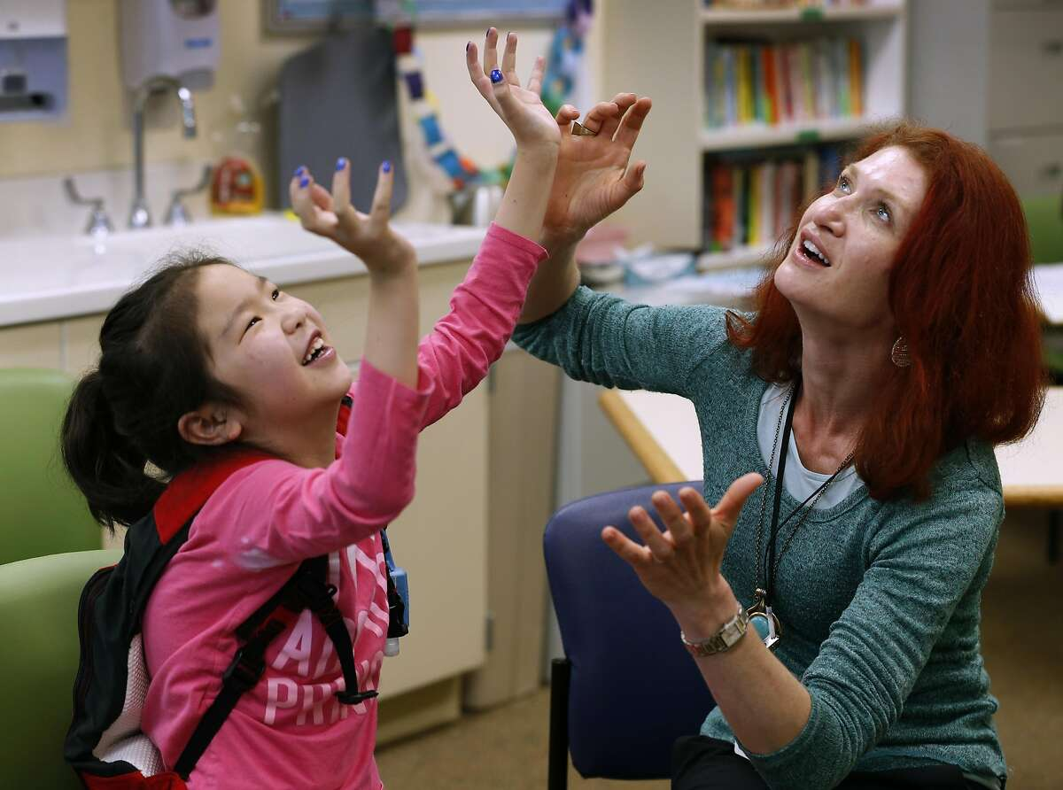 Ziyan Liu (left) and teacher Jenny Debevec mime a scene during an improvisation class for students at the Lucile Packard Children's Hospital school at Stanford.