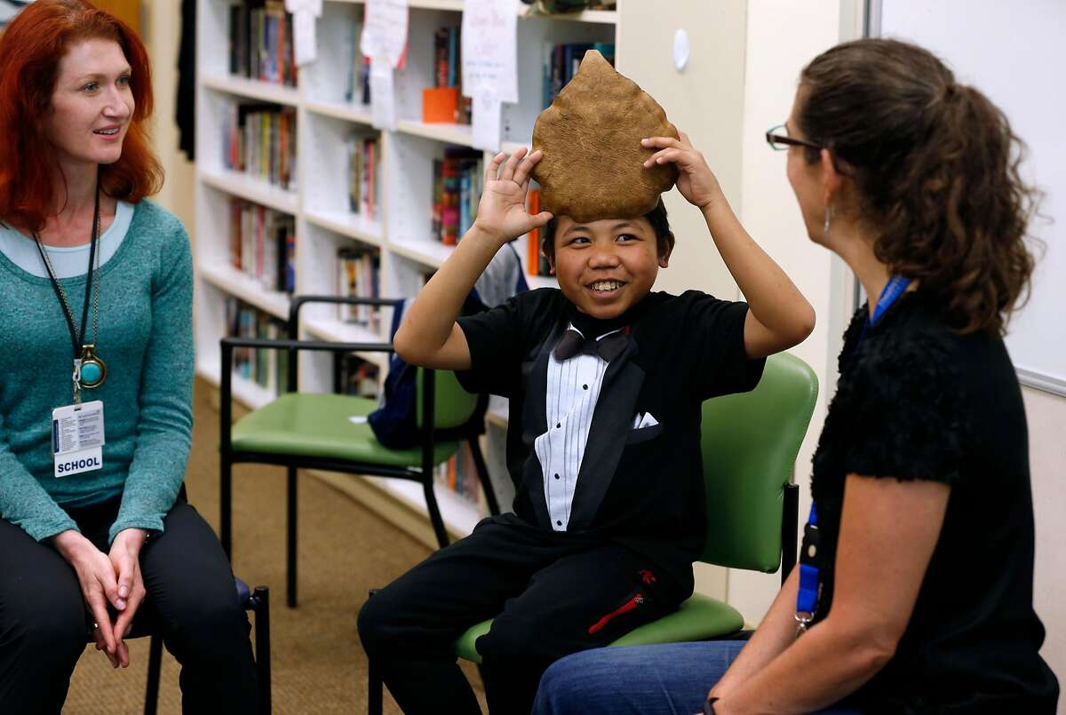 Keenan Espiritu, 15, plays an improvisation game during a class taught by Jenny Debevec (left) and Kelly Rinehart (right) at the Lucile Packard Children's Hospital school in Stanford, Calif. on Wednesday, May 24, 2017.