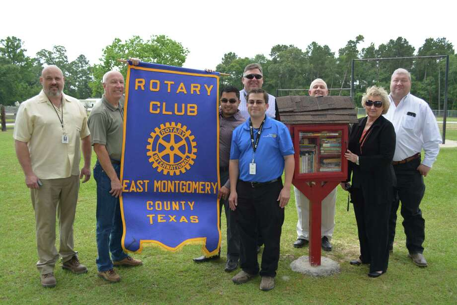 The first Rotary Club EMC Free Library was unveiled May 18 at Bull Sallas Park in New Caney. The library offers free books for anyone to read, take home and a place to donate books. Shown from left to right are Porter High School teacher Robert Barham, Rob Burgess, Jose Diosado, NCISD Superintendent Kenn Franklin, Rotary Club President Melecio Franco, Scott Castleberry, Barbara Knox and Montgomery County Pct. 4 Commissioner Jim Clark. Photo: Submitted