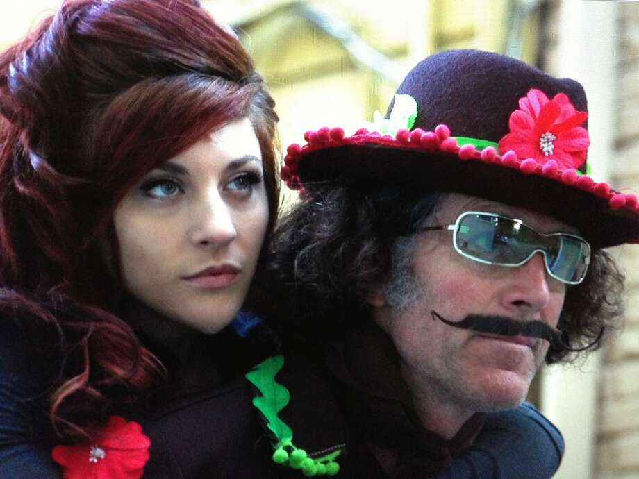 """Comic Michael Meehan, top, and above with Dwoira Galilea, stars in """"Hey Monster, Hands Off My City!"""" Photo: Mick LaSalle"""