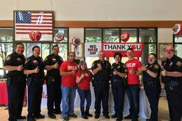 LPD and Walgreens employees, as well as Webb County Constable Harold Devally, pose for a photo Thursday at LPD headquarters for Red Nose Day.