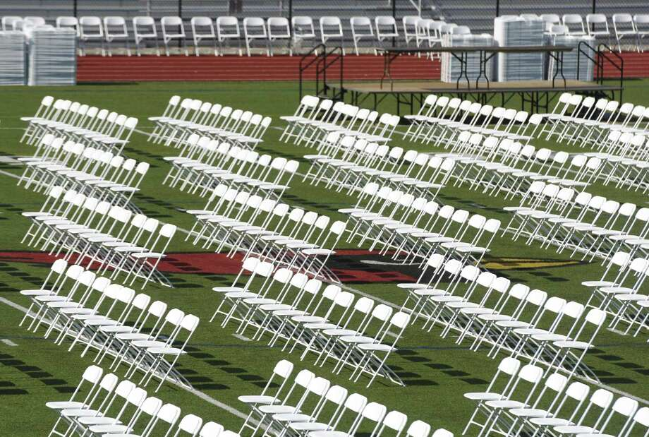 Empty chairs sit on the turf at Greenwich High School's Cardinal Stadium in Greenwich. , Conn. Monday, June 20, 2016. The GHS graduation ceremony begins Tuesday at 6:30 p.m. with ESPN's Hannah Storm as its keynote speaker. Photo: Tyler Sizemore / Hearst Connecticut Media / Greenwich Time